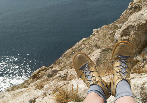 Feet hanging off a cliff